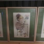 Kolm raamitud pilti